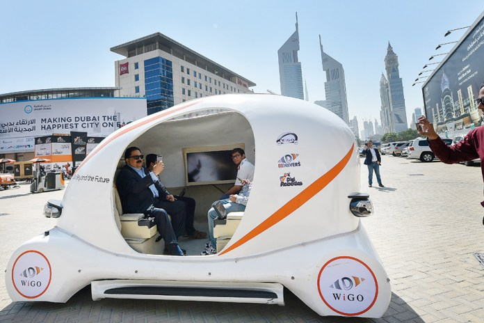 A demonstration of a 3D printed autonomous green car manufactured in the UAE during the 36th Gitex Technology Week in Dubai last year. Image Credit:Ahmed Ramzan/Gulf News Archives