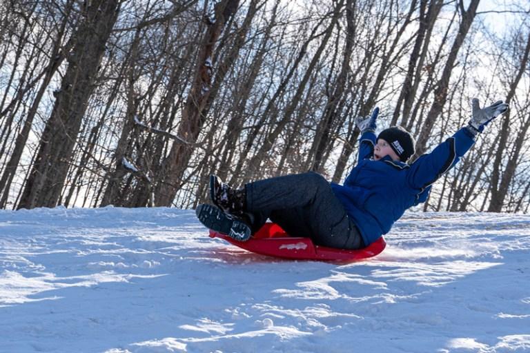Snow + sleds = smiles