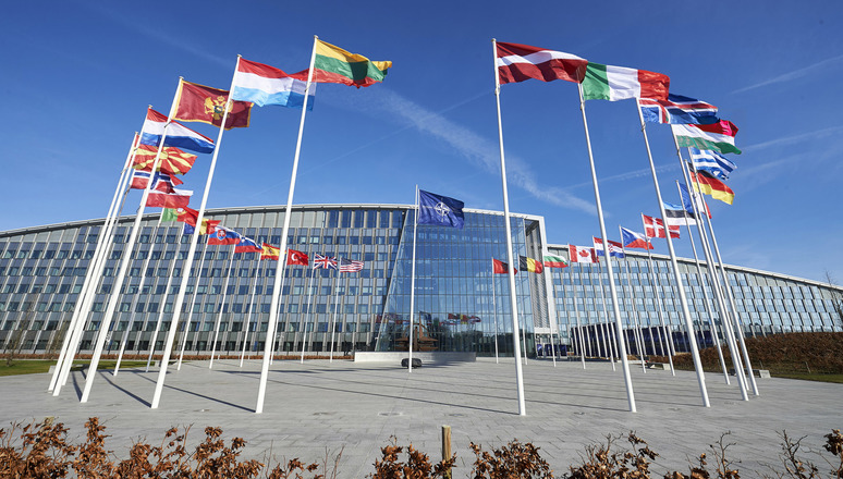 Confronting Biases in Policy-Engaged Research: The Case of NATO and Russia
