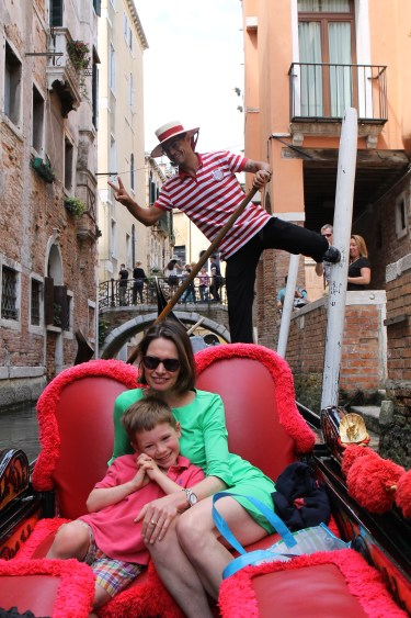 Chilling on the gondola ride and completely unaware of our gondolier hamming it up for the camera.