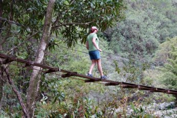 Since we drove to the other side of the island to ride the helicopter we went on a little hike...  A rope bridge?  Really?!
