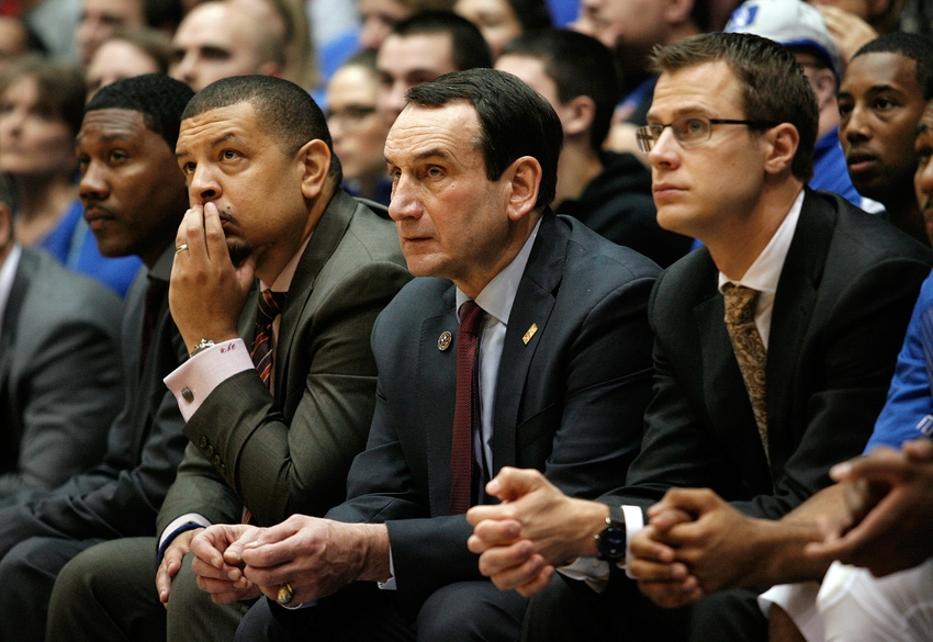 Dec 29, 2014; Durham, NC, USA; Duke Blue Devils assistant coach Nate James, associate head coach Jeff Capel, head coach Mike Krzyzewski and assistant coach Jon Scheyer watch their team against the Toledo Rockets in their game at Cameron Indoor Stadium. Mandatory Credit: Mark Dolejs-USA TODAY Sports