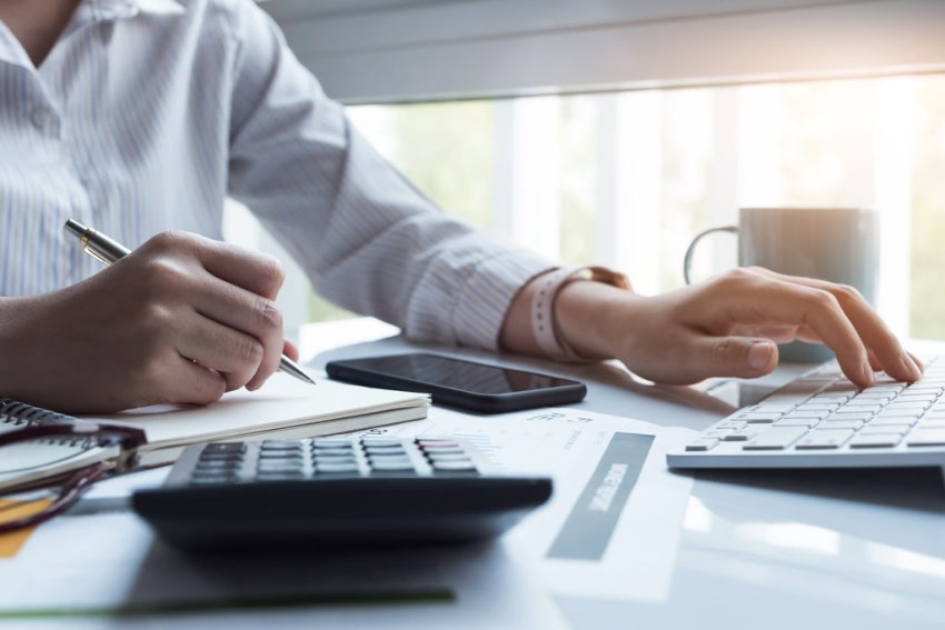 Managing Money When Employed And Self-Employed - Calculator, Laptop, Business Women