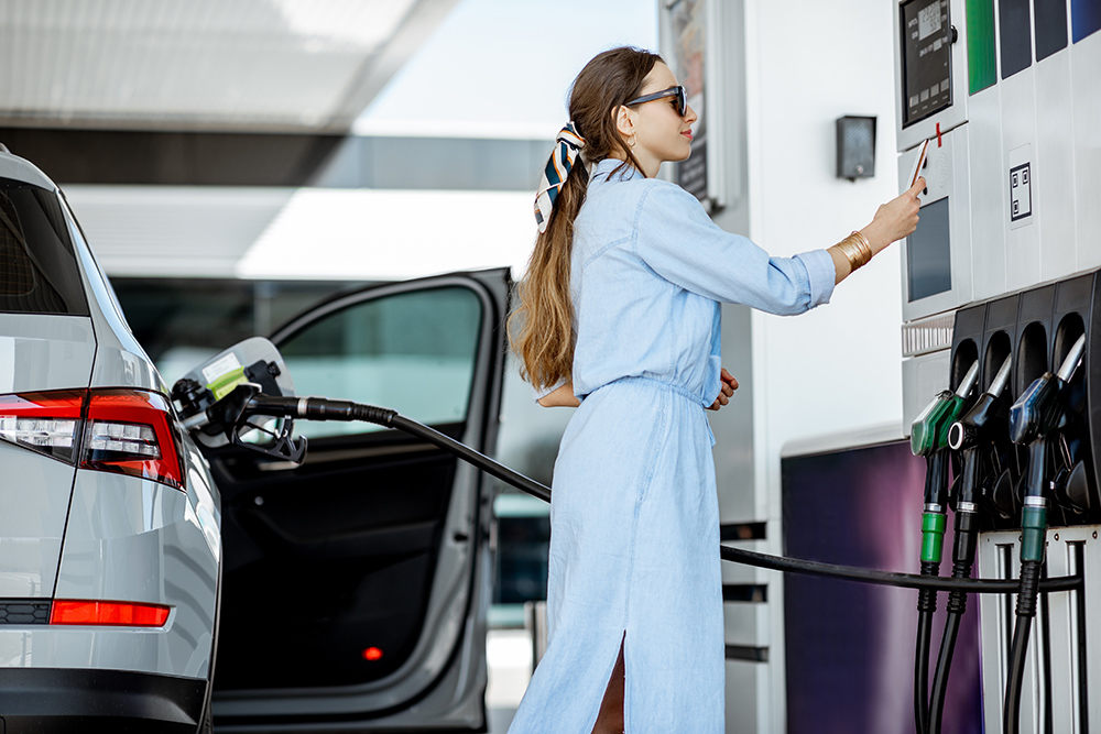Women paying for petrol with mobile phone