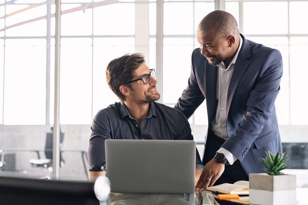 Mature executive helping new employee