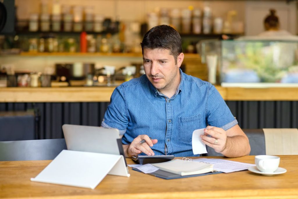 Small Business Owner Going Through Finances