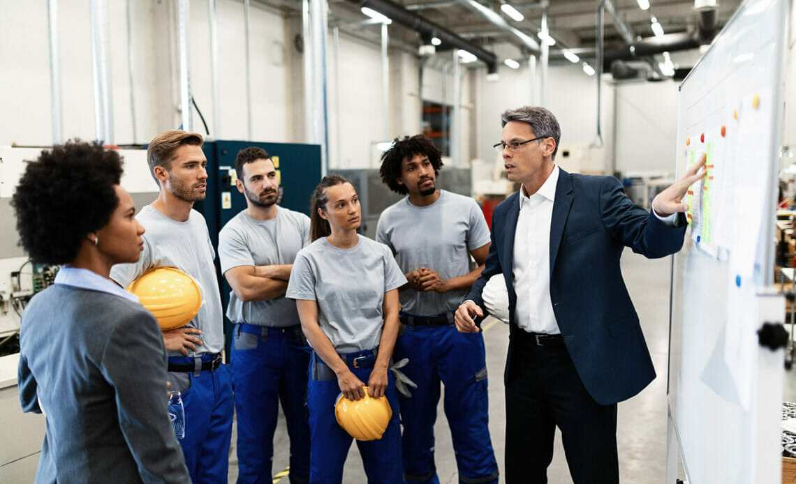 Factory employees and business man and women.
