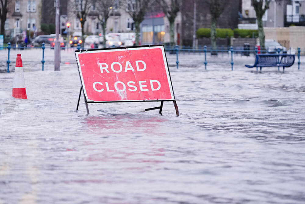 Road closed sign in road. Road flooded.
