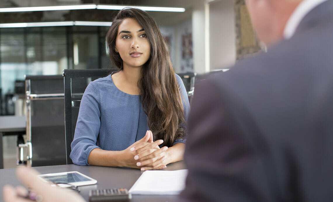Women at desk. Job interview