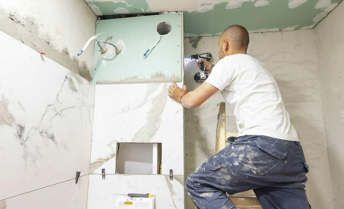 Workman renovating bathroom