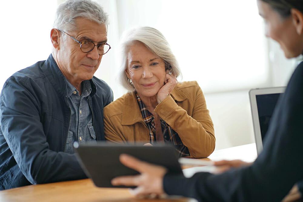 Mature/Elderly couple speaking to financial advisor