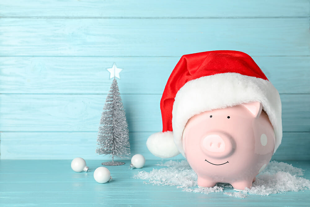 Piggy bank with Christmas hat and Christmas decorations