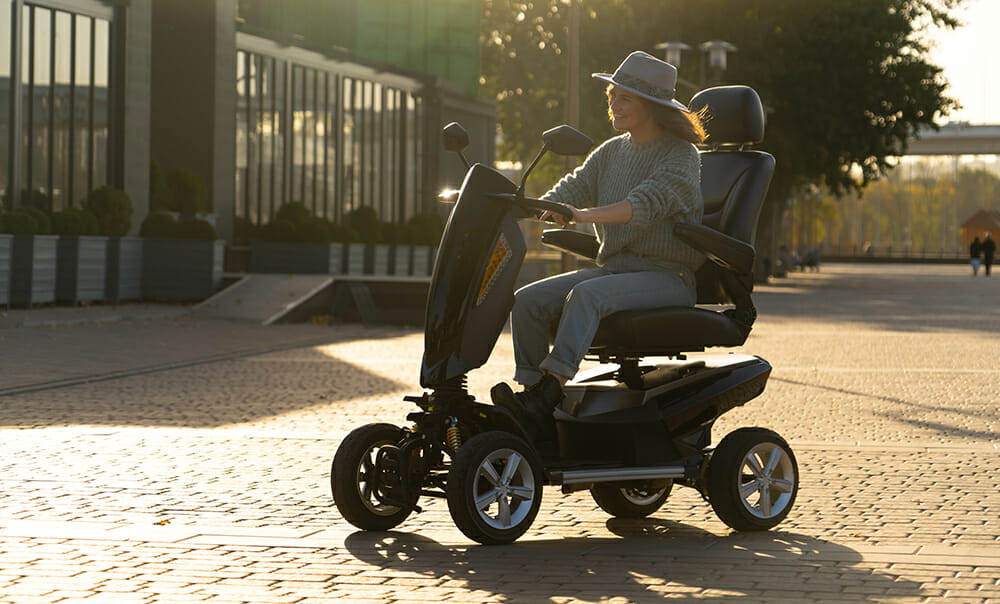 Women Driving Disability Scooter