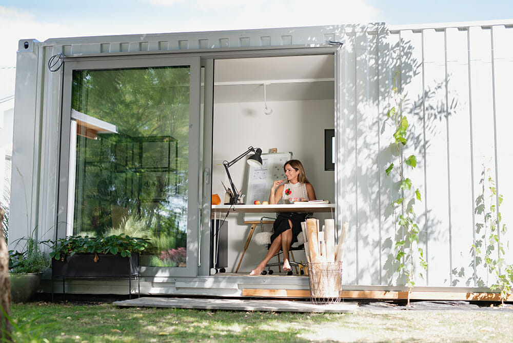 Women working in a garden office
