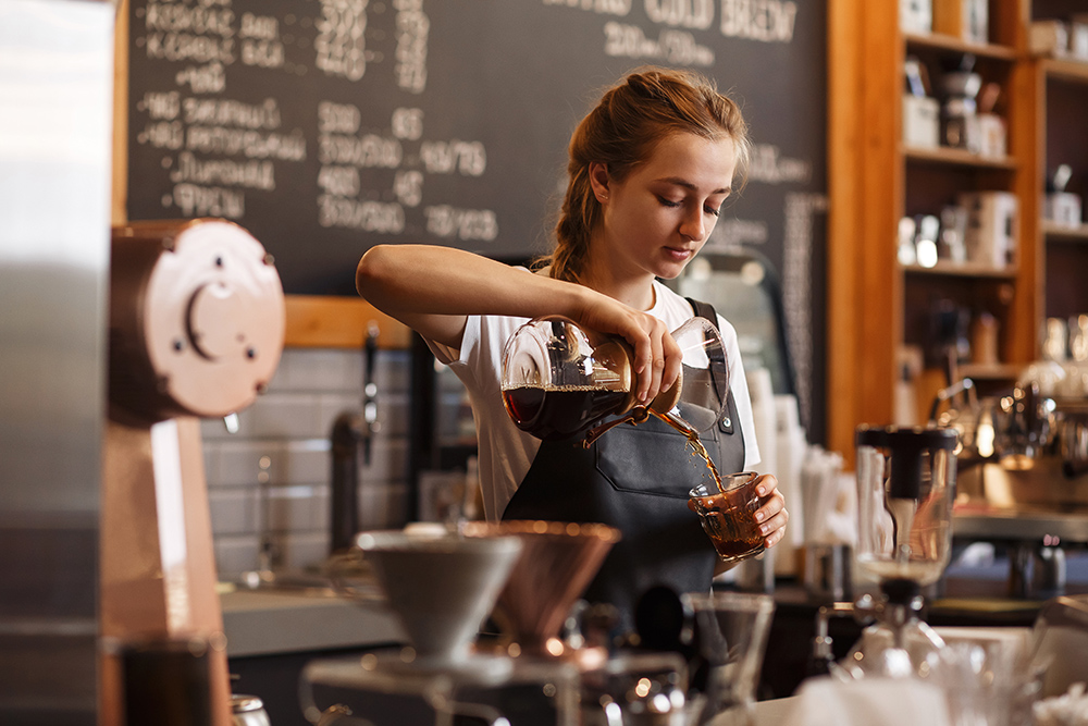 Young women serving coffee