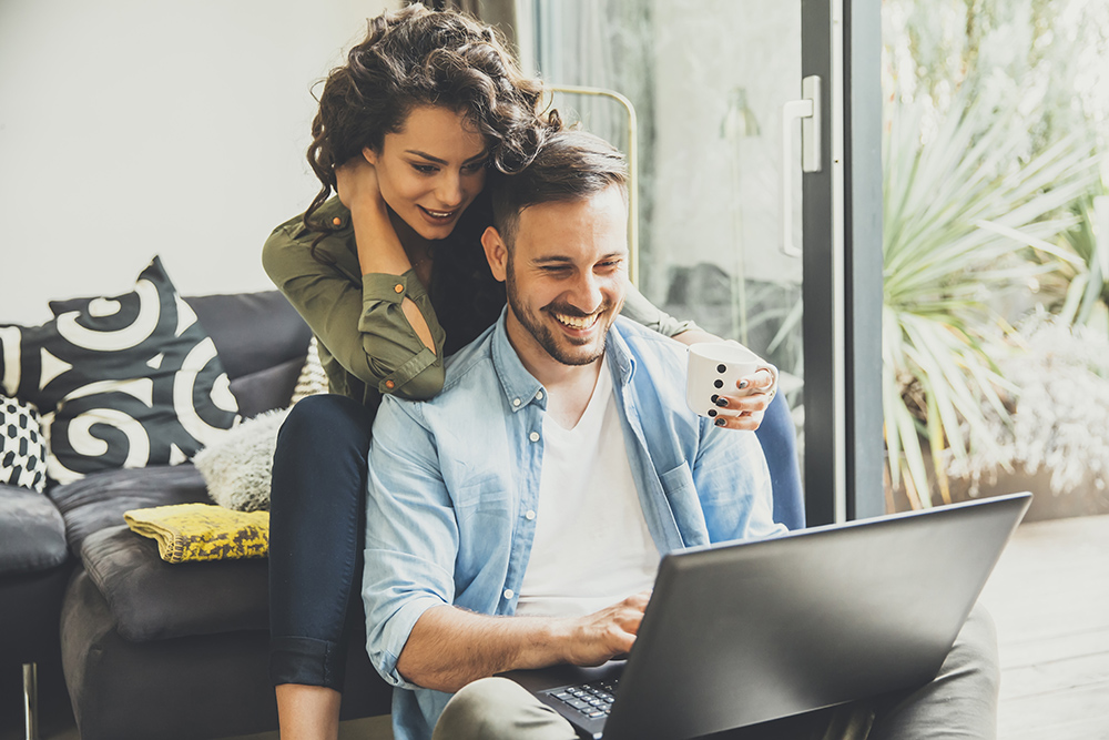 Young couple looking at laptop computer together