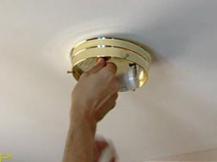 How to Replace a Ceiling Fixture   dummies 4Unscrew the screws or nuts holding the fixture base to the ceiling box