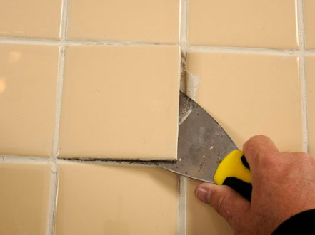 How to Fix Loose Ceramic Floor Tiles   dummies Lift out the loose tile with a putty knife