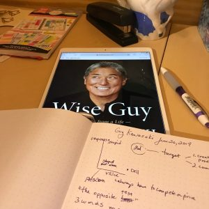 journal with notes and an ipad showing the cover of Guy Kawasaki's book Wise Guy