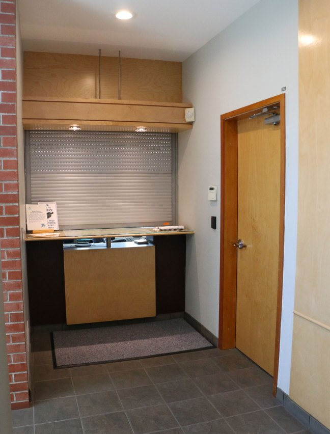 Matteus Clement in May 2018 is on the right. Could the CVRD not have left the projector on the counter to the left of the door? (photo by DuncanTaxpayers.ca)