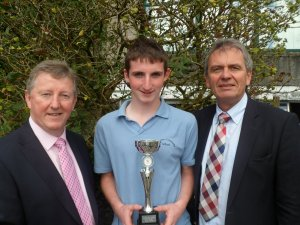 Dylan Hanley was awarded the Junior Sports Star award and is pictured with Minister of State Sean Canney and Gay McManus.