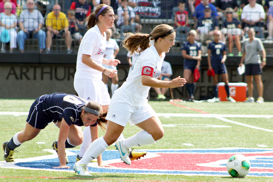 Claire Murray / The Duquesne Duke Junior captain Kahli Hale chases down a ball in women's soccer team's 1-0 loss to the University of Pittsburgh Sunday at Rooney Field.