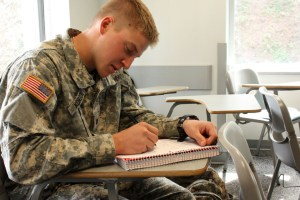 Photo by Claire Murray | The Duquesne Duke. Senior business major and ROTC student Tom Korzon writes in a notebook in class. Duquesne was named among the most military friendly schools in the nation based on the benefits and scholarships they provide to ROTC students.