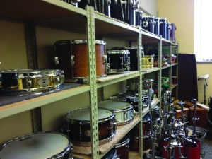 Photo by Andy Hornak | The Duquesne Duke. Instruments are stacked on shelves in a storage room in the Mary Pappert School of Music. According to the new Creative Colleges book by Elaina Loveland, the instruments are being put to good use, as the school ranks in the top 58 in the nation.