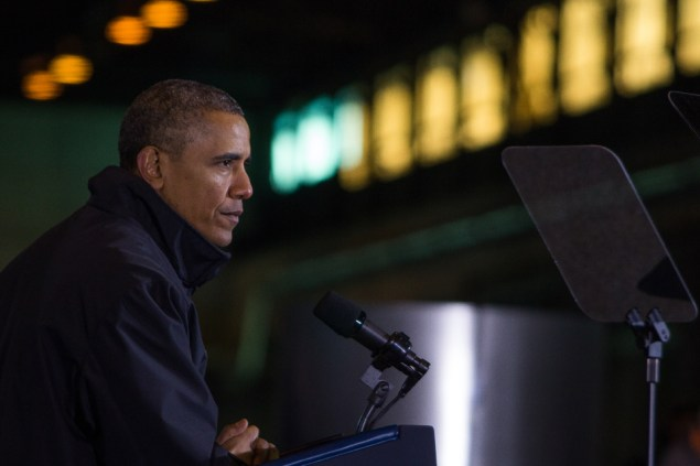 Photo by Aaron Warnick | Photo Editor. President Barack Obama speaks at the Mon Valley Works Irvin Plant in West Mifflin on Wednesday. Despite being indoors, the President and audience alike bundled up for the afternoon as he rehashed his State of the Union address.