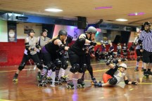 The Mon Monsters (black) took on the Penn Bruisers (gray) in the first bout Sunday. The Monster defeated the Bruisers 157 to 72.