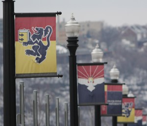 Photo by Aaron Warnick | Photo Editor. Duquesne street banners hang over Bluff Street. DU posted a 97 percent retention rate.