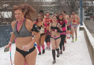 Photo by Katie Auwaerter | Asst. Features Editor. Pantsless runners in Saturday's Cupid's Undie Run charge through cold conditions.