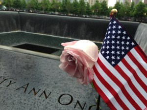 Photo by Julian Routh | News Editor. An American flag and rose are displayed next to a name on the National September 11 Memorial in New York City. The names of the nearly 3,000 people who died in the attacks line the outside of two reflecting pools the size of the Twin Towers.