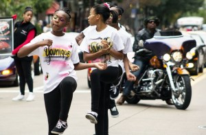 (Claire Murray / Photo Editor) Two young girls walk the parade route Saturday on Liberty Avenue. This year was the 27th African American Day Parade