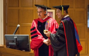 Photo by Claire Murray   Photo Editor. Law school dean Ken Gormley (left) shakes the hand of Costa Rican President Luis Guillermo Solís (right) after giving him an honorary degree Sept. 27.