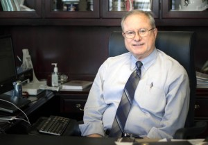 Photo by Claire Murray   Photo Editor. University President Charles Dougherty poses for a photo Monday in his office in the Administration Building. The 65 year-old announced last week that he will step down from his post on June 30, 2016, citing term limits and family as his reasons.