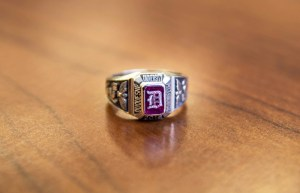 Photo by Claire Murray | Photo Editor. A Duquesne class ring reflects off of a table. The ring, which was created in the early 20th century, is one of the most recognizable rings in the country.