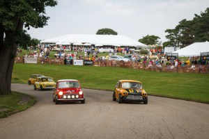(Photo Courtesy of Bill Stoler) Mini Coopers race around Schenley Park as part of the Pittsburgh Vintage Gran Prix.
