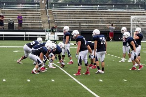 Members of the Duquesne Dukes football team line up for a practice drill Tuesday on Rooney Field. The Dukes begin their 2015 campaign Sept. 5 when they take on Kentucky Christian University at home.