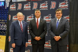 Harper (center), stands alongside Charles Dougherty (left) and John Plante (right) at the athletic director's introductory press conference Tuesday morning ainside the A.J. Palumbo Center.