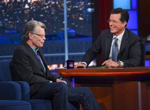 "AP Photo Stephen Colbert chats to Stephen King on his new late night talk show, ""The Late Show with Stephen Colbert."""