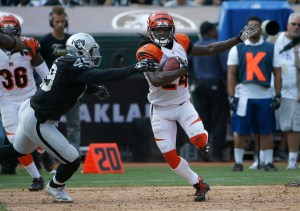 Cincinnati Bengals cornerback Adam Jones (24) runs against Oakland Raiders running back Jamize Olawale (49) during the first half of an NFL football game in Oakland, Calif., Sunday, Sept. 13, 2015. (AP Photo/Tony Avelar)