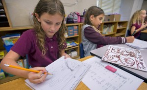 Ten-year-olds work on drawings of Mayan glyphs in class. Dual-language classrooms can help catch the United States up with the rest of the world in terms of speaking multiple foreign languages.