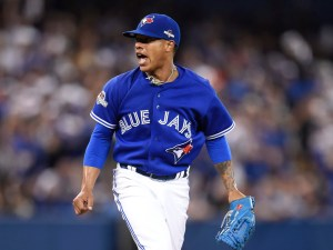 Toronto Blue Jays starting pitcher Marcus Stroman reacts after a pitch against the Kansas City Royals during the sixth inning in Game 3 of baseball's American League Championship Series on Monday, Oct. 19, 2015, in Toronto. (Frank Gunn/The Canadian Press via AP) MANDATORY CREDIT