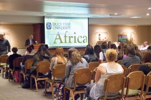 By Claire Murray | Photo Editor People gather the the Africa Room in the student union to listen to a speaker present on Africa Week.