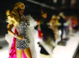 Barbie dolls are displayed at the 'Barbie Icon' exhibition, at Mudec (Museum of Cultures), in Milan, Italy. Barbie's newest commercial combats the negative anti-feminist stigma associated with the brand by showing girls they can become whoever they want to be.