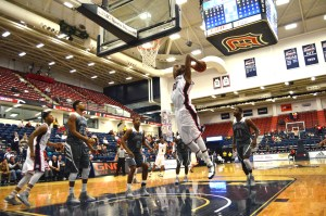 By Joseph Guzy | The Duquesne Duke Junior center Darius Lewis goes up for a dunk during the Dukes' 95-75 win over the New Orleans Privateers.