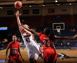 Photo from GoDuquesne. Freshman guard Kadri-Ann Lass goes to the rim for a contested layup in Saturday's win over St. John's.
