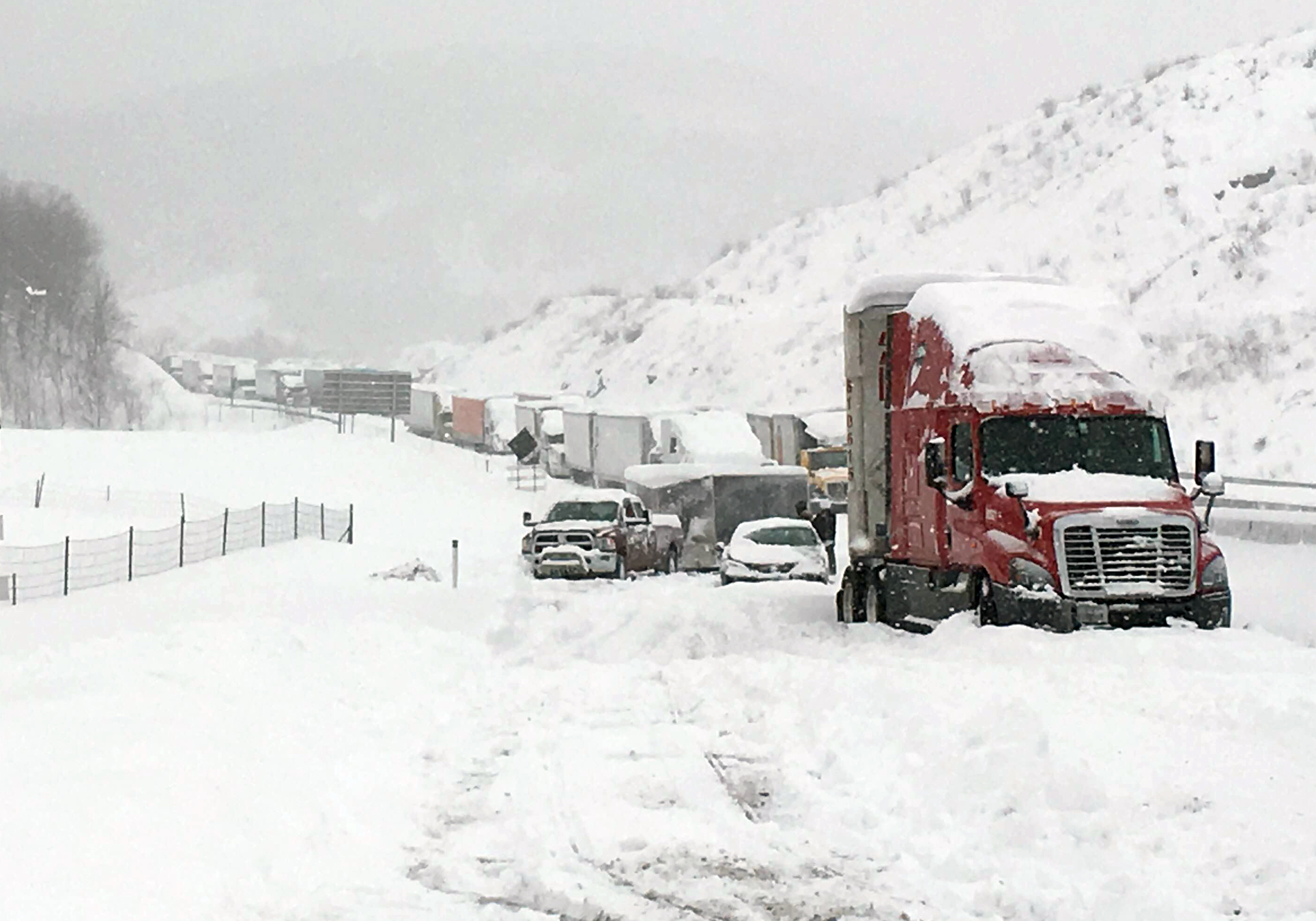 AP Photo - In this photo provided by Michael Watkins, traffic is at a standstill on the Pennsylvania Turnpike near Bedford, Pa., Saturday, Jan. 23, 2016. The Duquesne men's basketball team and Temple University's women's gymnastics team are stuck on the Turnpike due to treacherous weather conditions. A mammoth winter storm crawled up the U.S. East Coast on Saturday, making roads impassable, shutting down mass transit, and bringing Washington and New York City to a standstill.