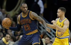 AP Photo - Cleveland Cavaliers' LeBron James, left,  drives past Golden State Warriors' Stephen Curry in the second half of an NBA basketball game, Monday, Jan. 18, 2016, in Cleveland. The Warriors won 132-98.